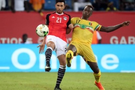Mahmoud Hassan of Egypt (l) battles for the ball with Mamoutou N' Diaye (r) of Mali during the 2017 Africa Cup of Nations match between Mali and Egypt at the Port Gentil Stadium in Gabon on 17 January 2017.