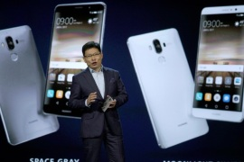 Richard Yu, Huawei CEO Consumer Business Group, talks about their Huawei Mate 9 smartphone just released to the U.S. market and displayed behind him during his keynote address at CES in Las Vegas, January 5, 2017.  REUTERS/Rick Wilking