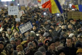 People wave placards and shout anti-government slogans during a protest rally in downtown Bucharest, Romania, 22 January 2017. Up to 30,000 people gathered in the evening in Romania's capital, blocking traffic, while protesting against the draft bill, put up for public debate, regarding a government ordinance to pardon those sentenced to jail terms shorter than five years, in the light that many Romanian parliament and administration members are having issues with just