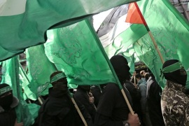 Fighters of Ezz-Al Din Al Qassam Brigades, the armed wing of the Palestinain Hamas movement march during a Hamas rally marking the group's 29th anniversary in the streets of Gaza City, 14 December 2016.