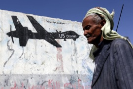 A Yemeni walks past a graffiti protesting US military operations in war-affected Yemen, in Sana'a, Yemen, 29 January 2017. According to reports, US Special Forces troops allegedly disembarked from US helicopters in the Yemeni town of Yakla and attacked several houses belonging to members of the terrorist group Al-Qaeda, killing three high-ranking Al-Qaeda members and nine civilians, six women and three children. One American serviceman has been killed and three injured