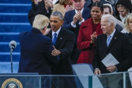 Former Vice President Joe Biden (R) watches as President Donald J. Trump (L) is embraced by former President Barack Obama (C) after delivering his Inaugural address after taking the oath of office as the 45th President of the United States in Washington, DC, USA, 20 January 2017. Trump won the 08 November 2016 election to become the next US President.