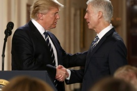 U.S. President Donald Trump shakes hands with Neil Gorsuch (R) after nominating him to be an associate justice of the U.S. Supreme Court at the White House in Washington, D.C., U.S., January 31, 2017.    REUTERS/Kevin Lamarque
