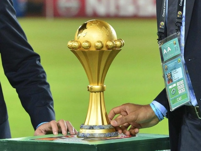 Confederation of African Football (CAF) ambassadors Mohamed Aboutrika (L) and Frederick Kanoute (R) with the trophy before the 2015 Africa Cup of Nations final soccer match between Ivory Coast and Ghana at the Bata Stadium in Bata, Equatorial Guinea, 08 February 2015.  EPA/BARRY ALDWORTH UK AND IRELAND OUT