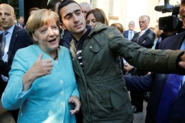 FILE PHOTO: Syrian refugee Anas Modaman takes a selfie with German Chancellor Angela Merkel outside a refugee camp near the Federal Office for Migration and Refugees after registration at Berlin's Spandau district, Germany September 10, 2015.  A German court will on February 6, 2017 hold its first hearing in the case of a Syrian refugee who is suing Facebook after the social networking site declined to remove all posts linking him to crimes and militant attacks.  REUTE