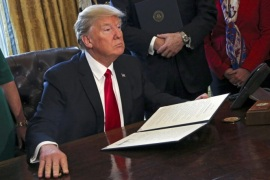 US President Donald J. Trump poses after signing an executive order in the Oval Office of the White House, in Washington, DC, USA, 03 February 2017. Trump signed several executive orders including an order to review the Dodd-Frank Wall Street to roll back financial regulations of the Obama era.