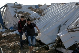 Palestinians inspect the rubble of a destroyed chicken farm which was allegedly hit by an Israeli airstrike overnight in the east of al-Shejaeiya neighbourhood near the border between Israel and Gaza Strip, 07 February 2017.