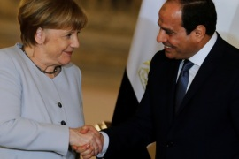 Egypt's President Abdel Fattah al-Sisi and German Chancellor Angela Merkel shake hands following a news conference at the El-Thadiya presidential palace in Cairo, Egypt, March 2, 2017. REUTERS/Amr Abdallah Dalsh  TPX IMAGES OF THE DAY