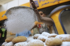 An Egyptian worker makes traditional sweets,