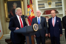 U.S. President Donald Trump speaks during a signing ceremony of executive orders on trade, accompanied by Vice President Mike Pence (C) and U.S. Commerce Secretary Wilbur Ross (2nd R) at the Oval Office of the White House in Washington, U.S., March 31, 2017.  REUTERS/Carlos Barria