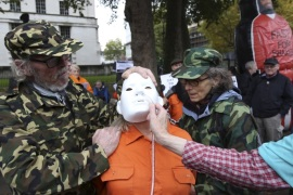 Supporters of Shaker Aamer, the last British prisoner at Guantanamo Bay, simulate a force feeding outside Downing street in central London, October 24, 2015. Aamer is to be returned to the UK after 13 years at the U.S. detention camp, the Foreign Office said in September. Aamer, a Saudi national who is married to a Briton, was never charged with any crime and had been cleared for release by U.S. authorities in 2007 but was not freed. Saturday marks Aamer's 5,000th day