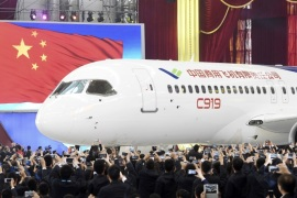 The first C919 passenger jet made by the Commercial Aircraft Corp of China (Comac) is pulled out during a news conference at the company's factory in Shanghai, November 2, 2015. Comac rolled out China's first homemade 158-seated C919 narrow body jet, which is meant to rival similar models from Airbus Group and Boeing Co. State television also showed footage of the aircraft rolling off the assembly line in Comac's Shanghai factory. In a statement, the company said it