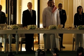 Qatar's Minister of Defense Khalid bin Mohammad Al-Attiyah (center right, in robe), U.S. Defence Secretary James Mattis (centre left, in dark suit) and U.S. Ambassador to Qatar Dana Shell Smith (R) stand for the playing of their national anthems before a dinner at the minister's residence in Doha, Qatar April 22, 2017. REUTERS/Jonathan Ernst
