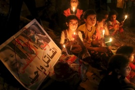 Palestinian children light candles during a rally to remember 18-month-old Palestinian baby Ali Dawabsheh, who was killed after his family's house was set on fire in a suspected attack by Jewish extremists, in Rafah in the southern Gaza Strip August 2, 2015. Suspected Jewish attackers torched a Palestinian home in the occupied West Bank on Friday, killing an 18-month-old toddler and seriously injuring three other family members, an act that Israel's prime minister described as terrorism. REUTERS/Ibraheem Abu Mustafa