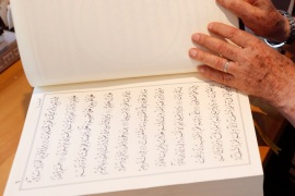 Lebanese calligrapher, Mahmoud Bayoun, turns the pages of the Koran that he wrote in Diwani font, at his office in Beirut, Lebanon June 23, 2017. Picture taken June 23, 2017. REUTERS/Mohamed Azakir