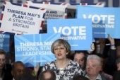 SOLIHULL, UNITED KINGDOM – JUNE 07:  Prime Minister Theresa May speaks during her last campaign visit at the National Conference Centre on June 7, 2017 in Solihull, United Kingdom. Britain goes to the polls tomorrow to vote in a general election.  (Photo by Carl Court/Getty Images)