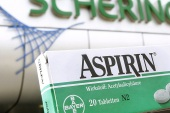 epa00676078 The picture shows a package of Aspirin pain reliever by Bayer in front of the main entrance of Schering AG in Berlin, Germany, Friday 24 March 2006. According to reports of both companies on late Thursday, 23 March 2006, the corporate group Schering and chemical big group Bayer Leverkusen surprisingly agreed on a merger. Photo: Wolfgang Kumm EPA/WOLFGANG KUMM