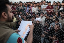 MOSUL, IRAQ – APRIL 15:  Men listen for their names to be called out by a camp official overseeing the return of refugees to recaptured parts of Mosul, in Khazir refugee camp on April 15, 2017 near Mosul, Iraq. Khazir camp, with a capacity of roughly 30,000 and along with several other camps near the city of Mosul, provides home for the approximately 300,000 people who have fled Iraq's second largest city as Iraqi government forces continue the military campaign to rec