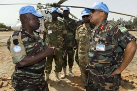 UNAMID Force Commander, Lieutenant General Patrick Nyamvumba (R), speaks to a UN soldier during his visit at the Nertiti UNAMID Camp Site, West Darfur.