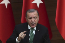 Turkish President Recep Tayyip Erdogan speaks during the 39th Mukhtars Meeting, at Presidential Complex in Ankara, on August 22, 2017.President Recep Tayyip Erdogan on August 22, 2017 vowed Turkey would thwart any attempt by a Kurdish militia it deems 'terrorists' to carve out a Kurdish state in northern Syria. Ankara views the Kurdish Peoples' Protection Units (YPG) and the Kurdish Democratic Party (PYD) as a terror group. But the United States is closely allied wit