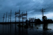 Flood waters from Tropical Storm Harvey surround a power sub-station in Iowa, Calcasieu Parish, Louisiana, U.S., on August 29, 2017. REUTERS/Jonathan Bachman