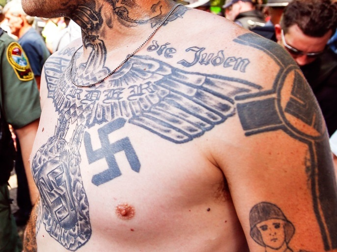 A supporter of the Ku Klux Klan is seen with his tattoos during a rally at the statehouse in Columbia, South Carolina July 18, 2015. REUTERS/Chris Keane