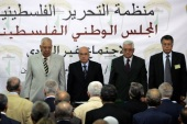 (L-R) Palestinian National Council vice chairman Taysir Qubaa, chairman Salim al-Zaanun, Palestinian president Mahmud Abbas and Palestinian representative to the Arab League Mohammed Sabih chair a PNC meeting in the West Bank city of Ramallah on August 26, 2009. The parliament of the Palestine Liberation Organisation (PLO) began its first meeting in more than a decade in the occupied West Bank to replace leaders who have died. The PNC will pick six new members of the 18-strong PLO Executive Committee headed by Abbas. AFP PHOTO/ABBAS MOMANI (Photo credit should read ABBAS MOMANI/AFP/Getty Images)