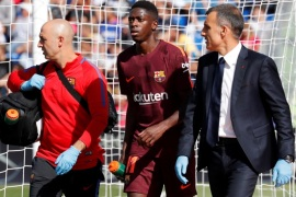 Soccer Football – Santander La Liga – Getafe CF vs FC Barcelona – Coliseum Alfonso Perez, Getafe, Spain – September 16, 2017   Barcelona's Ousmane Dembele receives medical attention after sustaining an injury    REUTERS/Paul Hanna