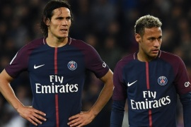 Paris Saint-Germain's Uruguayan forward Edinson Cavani (L) and Paris Saint-Germain's Brazilian forward Neymar react during the French Ligue 1 football match between Paris Saint-Germain (PSG) and Lyon (OL) on September 17, 2017 at the Parc des Princes stadium in Paris.  / AFP PHOTO / FRANCK FIFE        (Photo credit should read FRANCK FIFE/AFP/Getty Images)