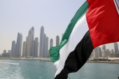 UAE flag flies over a boat at Dubai Marina, Dubai, United Arab Emirates May 22, 2015. REUTERS/Ahmed Jadallah