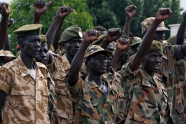 South Sudanese soldiers cheer during a ceremony marking the thirty fourth anniversary of the Sudan People's Liberation Army (SPLA) at the military headquarters in Juba, South Sudan May 18, 2017. REUTERS/Jok Solomun