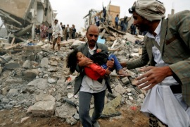 A man carries Buthaina Muhammad Mansour, believed to be four or five, rescued from the site of a Saudi-led air strike that killed eight of her family members in Sanaa, Yemen August 25, 2017.  REUTERS/Khaled Abdullah/File Photo SEARCH