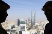 Men look out of a building as the Kingdom Centre Tower is seen in Riyadh, Saudi Arabia, January 1, 2017. REUTERS/Faisal Al Nasser