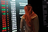 A Saudi investor monitors the stock exchange at the Saudi Stock Exchange, or Tadawul, on December 14, 2016  in the capital Riyadh. / AFP PHOTO / FAYEZ NURELDINE        (Photo credit should read FAYEZ NURELDINE/AFP/Getty Images)