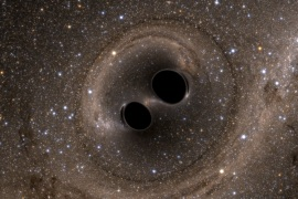 The collision of two black holes  – a tremendously powerful event detected for the first time ever by the Laser Interferometer Gravitational-Wave Observatory, or LIGO – is seen in this still image from a computer simulation released in Washington February 11, 2016. Scientists have for the first time detected gravitational waves, ripples in space and time hypothesized by Albert Einstein a century ago, in a landmark discovery announced on Thursday that opens a new window