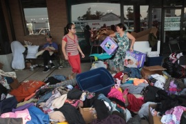 ORANGE, TX – SEPTEMBER 03:  Flood victims search through donated items after torrential rains pounded Southeast Texas following Hurricane and Tropical Storm Harvey causing widespread flooding on September 3, 2017 in Orange, Texas. Harvey, which made landfall north of Corpus Christi August 25, has dumped nearly 50 inches of rain in and around areas Houston.  (Photo by Scott Olson/Getty Images)