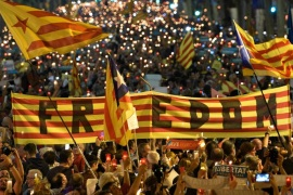 People attend a candle-lit demonstration in Barcelona against the arrest of two Catalan separatist leaders on October 17, 2017.Catalonia braced for protests after a judge ordered the detention of two powerful separatist leaders, further inflaming tensions in the crisis over the Spanish region's chaotic independence referendum. / AFP PHOTO / LLUIS GENE        (Photo credit should read LLUIS GENE/AFP/Getty Images)