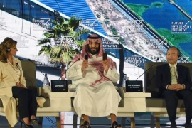Saudi Crown Prince Mohammed bin Salman (C), US journalist Maria Bartiromo (L) and Masayoshi Son, the Chief Executive Officer of SoftBank, attend the Future Investment Initiative (FII) conference in Riyadh, on October 24, 2017.The Crown Prince pledged a 'moderate, open' Saudi Arabia, breaking with ultra-conservative clerics in favour of an image catering to foreign investors and Saudi youth.  'We are returning to what we were before — a country of moderate Islam that
