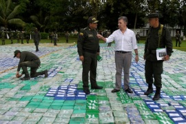 Colombia's President Juan Manuel Santos looks on after the seizure of more than 12 tons of cocaine in Apartado, Colombia November 8, 2017. Colombian Presidency/Handout via REUTERS    ATTENTION EDITORS –  THIS IMAGE HAS BEEN SUPPLIED BY A THIRD PARTY