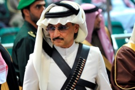 Prince Alwaleed bin Talal attends the traditional Saudi dance known as 'Arda', which was performed during Janadriya culture festival at Der'iya in Riyadh February 18, 2014. REUTERS/Fayez Nureldine/Pool/File Photo