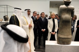 Abu Dhabi Crown Prince Mohammed bin Zayed Al-Nahyan (2ndL), President-Director of the Louvre Museum, Jean-Luc Martinez (3rdL) French President Emmanuel Macron (2ndR) and his wife Brigitte Macron (R) look at a piece of art as they visit the Louvre Abu Dhabi Museum in Abu Dhabi, UAE,  November 8, 2017. Picture taken November 8, 2017.   REUTERS/Ludovic Marin/Pool