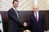 epa06341426 Russian President Vladimir Putin (R) shakes hands with Syrian President Bashar al-Assad (L) during their meeting in the Black sea resoert of Sochi, Russia, 20 November 2017 (issued 21 November 2017). According to reports the two leaders met over talks focusing on the Syrian conflict.  EPA-EFE/MICHAEL KLIMENTYEV/SPUTNIK/KREMLIN / POOL MANDATORY CREDIT