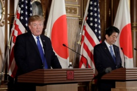 U.S. President Donald Trump speaks as Shinzo Abe, Japan's prime minister, looks on during a news conference at Akasaka Palace in Tokyo, Japan, November 6, 2017. REUTERS/Kiyoshi Ota/Pool