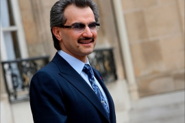 epa01415051 Prince Alwaleed Bin Talal Bin Abdulaziz Al Saud from Saudi Arabia leaves the Elysee Palace, in Paris, France, 16 July 2008, after a meeting with French President Nicolas Sarkozy. Both will arrive at the Louvre Museum to put the first stone of the Islamic Arts Room after the meeting.  EPA/LUCAS DOLEGA