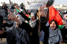 Protesters shout slogans during a protest near the U.S. Embassy in Amman, Jordan December 13, 2017. The placard reads,