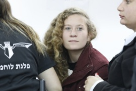 epa06399700 17 year old Palestinian Ahed Tamimi (C), a campaigner against Israel's occupation, appears at a military court at the Israeli-run Ofer prison in the West Bank village of Betunia, 20 December 2017.