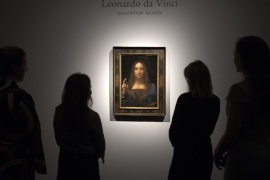 LONDON, ENGLAND – OCTOBER 24: Staff members pose next to a painting by Leonardo da Vinci entitled 'Salvator Mundi' before it is auctioned in New York on November 15, at Christies on October 24, 2017 in London, England. The painting is the last Da Vinci in private hands and is expected to fetch around 100,000,000 USD.  (Photo by Carl Court/Getty Images)