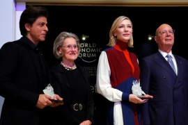 Actor Cate Blanchett and actor Shah Rukh Khan pose for the media after receiving the Crystal Awards, with Hilde Schwab, Chairperson and Co-Founder, Schwab Foundation for Social Entrepreneurship and Klaus Schwab, Founder and Executive Chairman of the WEF, at the annual meeting of the World Economic Forum (WEF) in Davos, Switzerland January 22, 2018. REUTERS/Denis Balibouse
