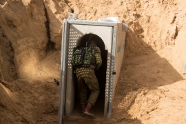 An Israeli soldier enters what the Israeli military say is a cross-border attack tunnel dug from Gaza to Israel, on the Israeli side of the Gaza Strip border near Kissufim January 18, 2018. REUTERS/Jack Guez/Pool