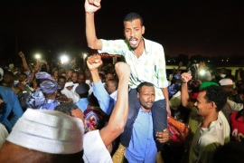 Supporters carry a released politician outside the National Prison, after demonstrations in Khartoum, Sudan February 18, 2018. REUTERS/Mohamed Nureldin Abdallah